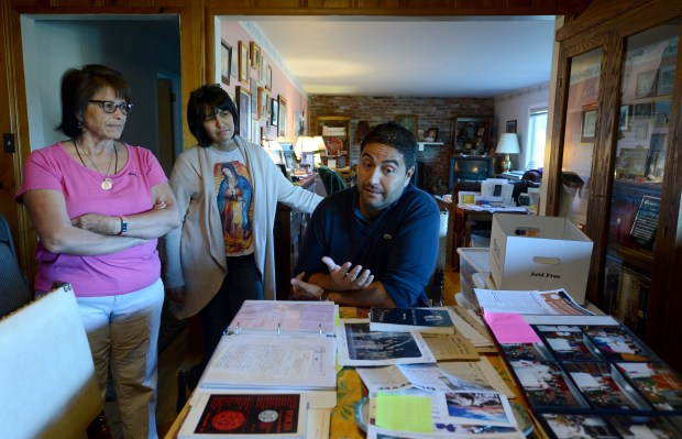 Stanford archivist Ignacio Ornelas, right, talks about the wealth of history being made available thanks to Sylvia, left, and Serena Alvarez at the Alvarez home in San Jose, Calif., on Friday, Oct. 6, 2017. Researchers at Stanford are in the early stages of archiving the work of the late Sal Alvarez, a Latino civil rights icon in San Jose who passed away in 2015. His family is donating over 100 boxes of personal items, documents and photos to continue his legacy and make these historical items accessible to the public. (Dan Honda/Bay Area News Group)