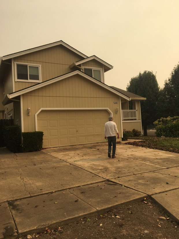 Bernard Gibson returns to his family's home in the Coffey Park neighborhoodin Santa Rosa. The house was still standing after a firestorm tore through the neighborhood in the early morning of Oct. 9. (Courtesy Gibson family).