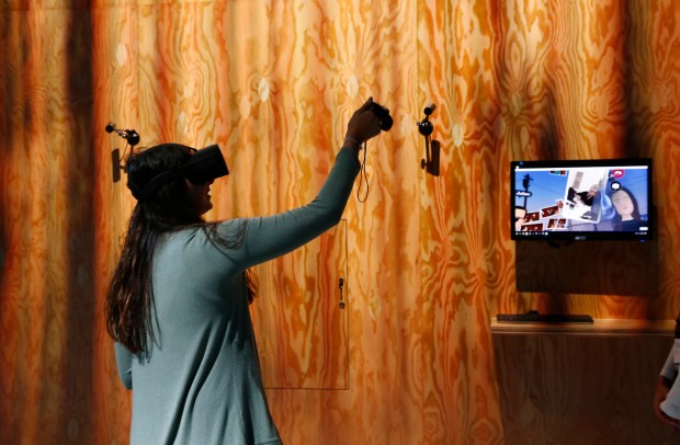 Kristin Crist, of San Jose, tries out Facebook Spaces at Oculus Connect 4 at the San Jose McEnery Convention Center in San Jose, California, on Wednesday, Oct. 11, 2017. (Gary Reyes/ Bay Area News Group)