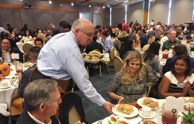 Santa Clara County Supervisor Joe Simitian serves lunch to a table at the Silicon Valley Council of Nonprofits' annual Be Our Guest luncheon. (Sal Pizarro/Bay Area News Group)