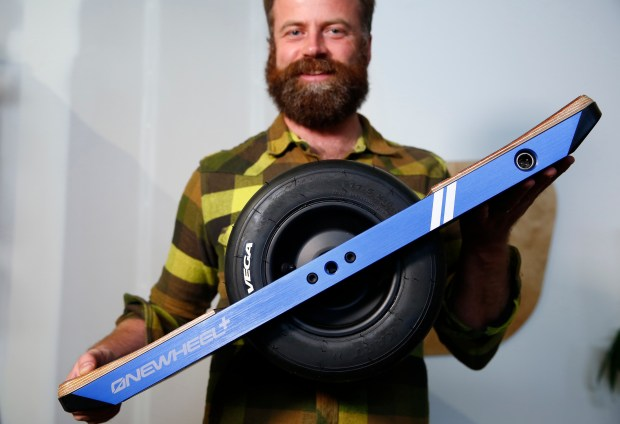 Kyle Doerksen shows off the Onewheel transportation device he invented at his office at Future Motion in Santa Cruz, California, on Monday, Oct. 30, 2017. Onewheel is an electric powered board that rides on a single go-kart racing slick that gives the sensation of snowboarding on pavement or off road. (Gary Reyes/ Bay Area News Group)
