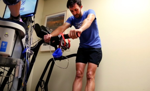 Mikal Davis, a 30-year-old researcher at Facebook and national-class duathlete, catches his breath after performing a grueling treadmill test for Stanford's ELITE study at Stanford Medical Center in Stanford, Calif. on April, 25, 2017. The study aims to identify genetic mutations responsible for superior heart function. (Courtney Cronin, Bay Area News Group)