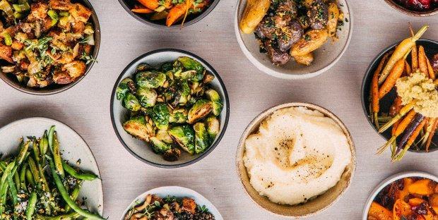 Whole Foods Market has added new sides to its holiday takeout offeringsthis year, including maple-roasted brussels sprouts and sauerkraut-roasted rainbow carrots (Photo: Whole Foods Market).