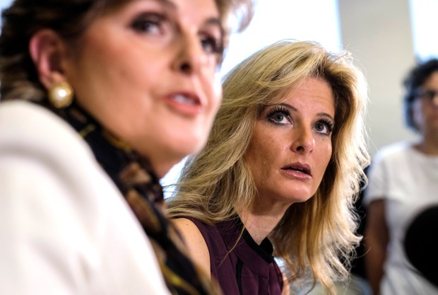 "FILE - In this Oct. 14, 2016, file photo, Summer Zervos, right, listens alongside her attorney Gloria Allred during a news conference in Los Angeles. Trump's presidential campaign has been subpoenaed for records related to past sexual assault allegations against Trump _ charges the president on Oct. 16 dismissed as ""made-up stuff."" Lawyers for Zervos, a former contestant on ""The Apprentice,"" asked the campaign in March 2017 to preserve any records in its possession concerning Zervos or other women who accused Trump of misconduct. Zervos says Trump kissed and groped her against her will in 2007. During a Rose Garden news conference, Trump dismissed the allegations as politically motivated. (AP Photo/Ringo H.W. Chiu, file)"