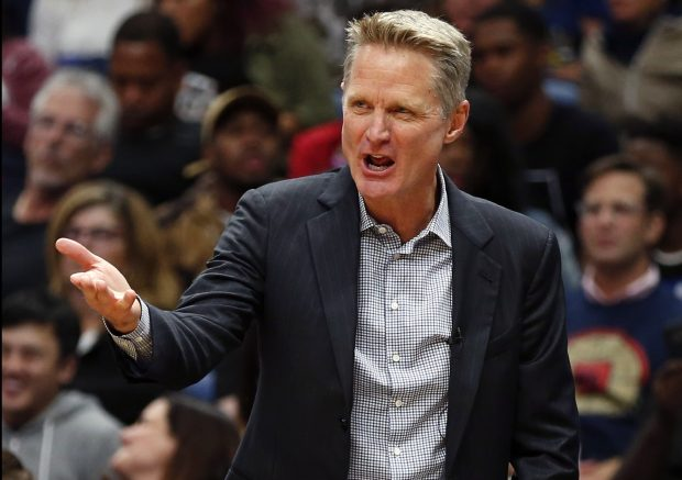 Golden State Warriors head coach Steve Kerr calls out from the bench in the first half of an NBA basketball game against the New Orleans Pelicans in New Orleans, Friday, Oct. 20, 2017. (AP Photo/Gerald Herbert)