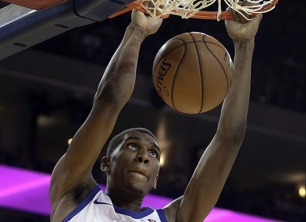 Warriors third-year forward Kevon Looney earned praise for his play in the Warriors' 124-114 victory over the Houston Rockets on Thursday. (AP Photo/Ben Margot)