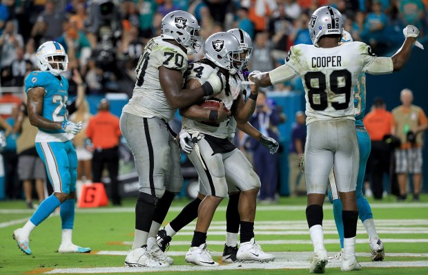 MIAMI GARDENS, FL - NOVEMBER 05: Marshawn Lynch #24 of the Oakland Raiders celebrates a touchdown during a game against the Miami Dolphins at Hard Rock Stadium on November 5, 2017 in Miami Gardens, Florida. (Photo by Mike Ehrmann/Getty Images)