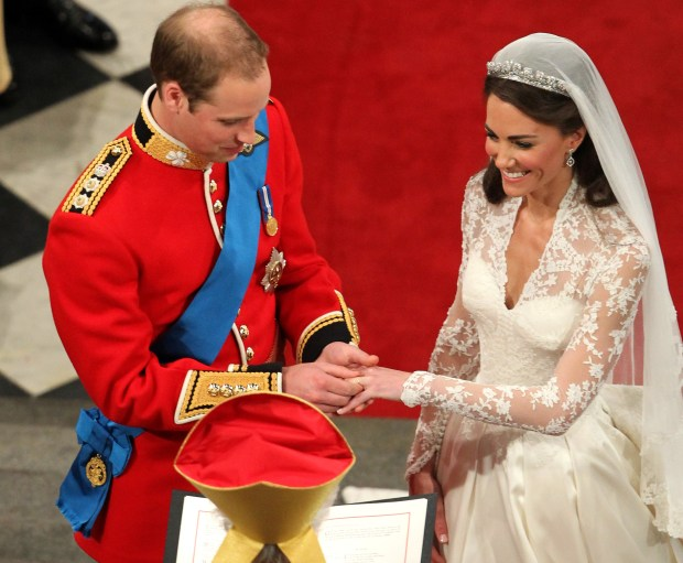 Prince William places the ring on the hand of Kate Middleton, at Westminster Abbey during their wedding service at Westminster Abbey, central London, Friday April 29, 2011. (AP Photo/Andrew Milligan, Pool)