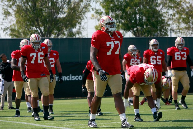San Francisco 49ers' Trent Brown (77) gets loose with teammates, Wednesday, Aug. 2, 2017, at training camp in Santa Clara, California. (Karl Mondon/Bay Area News Group)