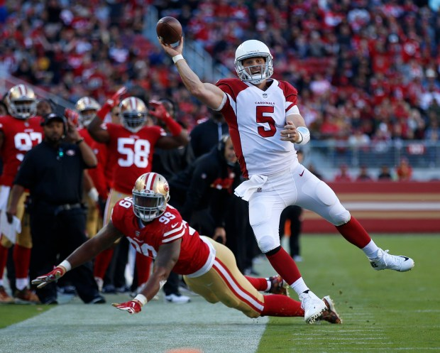 Arizona Cardinals starting quarterback Drew Stanton (5) throws the ball out-of-bounds under pressure by San Francisco 49ers' DeForest Buckner (99) in the fourth quarter of their NFL game at Levi's Stadium in Santa Clara, Calif. on Sunday, Nov. 5, 2017. (Nhat V. Meyer/Bay Area News Group)