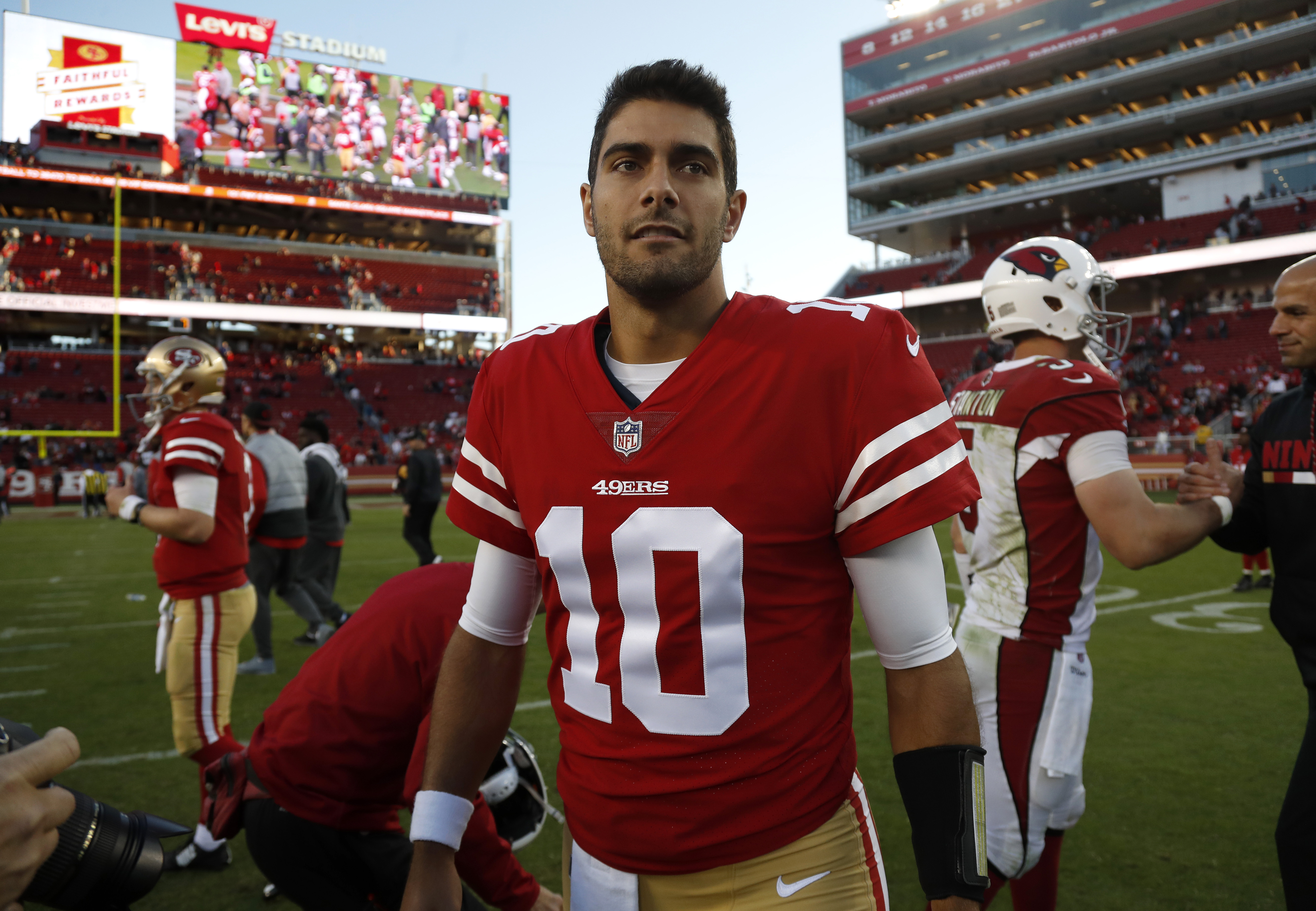San Francisco 49ers Jimmy Garoppolo walks on the field following the 49ers 20-10 loss against the Arizona Cardinals for their NFL game at Levi's Stadium in Santa Clara Calif. on Sunday Nov. 5 2017