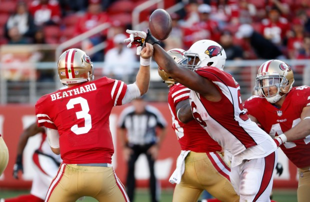 San Francisco 49ers starting quarterback C.J. Beathard (3) throws is blocked by Arizona Cardinals' Kareem Martin (96) in the second quarter of their NFL game at Levi's Stadium in Santa Clara, Calif. on Sunday, Nov. 5, 2017. (/Bay Area News Group) (Josie Lepe/Bay Area News Group)