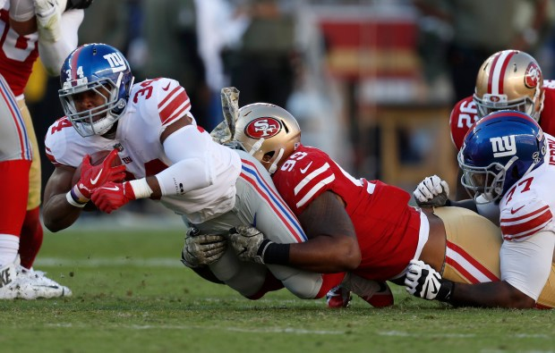 San Francisco 49ers' DeForest Buckner (99) tackles against New York Giants' Shane Vereen (34) in the second quarter of their NFL game in Santa Clara, Calif. on Sunday, Nov. 12, 2017. (Nhat V. Meyer/Bay Area News Group)