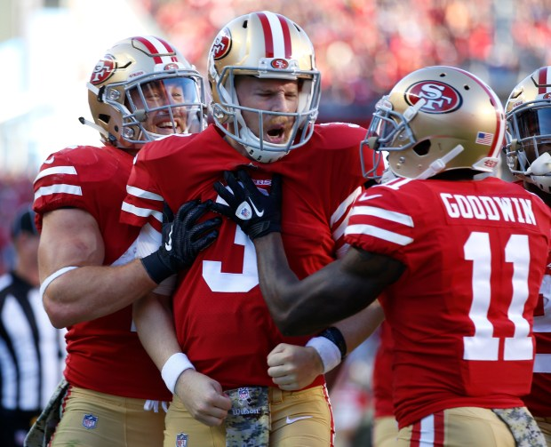 San Francisco 49ers starting quarterback C.J. Beathard (3) celebrates his touchdown scramble with San Francisco 49ers' Marquise Goodwin (11) against the New York Giants in the fourth quarter of their NFL game in Santa Clara, Calif. on Sunday, Nov. 12, 2017. (Nhat V. Meyer/Bay Area News Group)