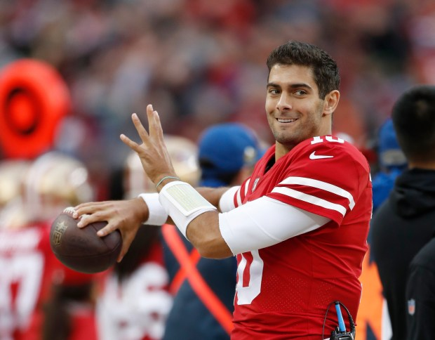 San Francisco 49ers' Jimmy Garoppolo (10) warms up on the sidelines against Seattle Seahawks in the second quarter of their NFL game at Levi's Stadium in Santa Clara, Calif. on Sunday, Nov. 26, 2017. (Josie Lepe/Bay Area News Group)