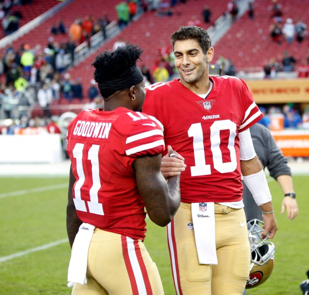 San Francisco 49ers' Marquise Goodwin (11) shakes hands with San Francisco 49ers' Jimmy Garoppolo (10) at the end of game against Seattle Seahawks in the fourth quarter of their NFL game at Levi's Stadium in Santa Clara, Calif. on Sunday, Nov. 26, 2017. (Josie Lepe/Bay Area News Group)