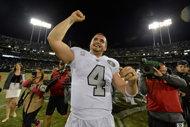 Oakland Raiders quarterback Derek Carr (4) celebrates after defeating the Kansas City Chiefs during their NFL game at the Coliseum in Oakland, Calif. on Thursday, Oct. 19, 2017. Oakland defeated Kansas City 31-30. (Jose Carlos Fajardo/Bay Area News Group)