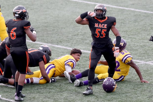 McClymonds' Ramone Sanders (55) reacts after a tackle on Oakland Tech's Jacob Harris (5) in the first half of the Silver Bowl football game at Laney College in Oakland, Calif., on Saturday, Nov. 25, 2017. McClymonds went on to win the game 42-14 and has won the bowl game for eight consecutive seasons. (Ray Chavez/Bay Area News Group)