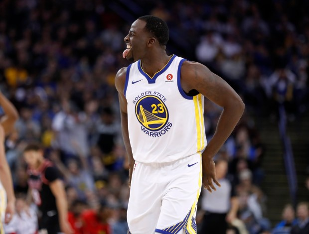 Golden State Warriors' Draymond Green (23) celebrates his 3-point basket against the Miami Heat in the fourth quarter at Oracle Arena in Oakland, Calif. on Monday, Nov. 6, 2017. (Nhat V. Meyer/Bay Area News Group)