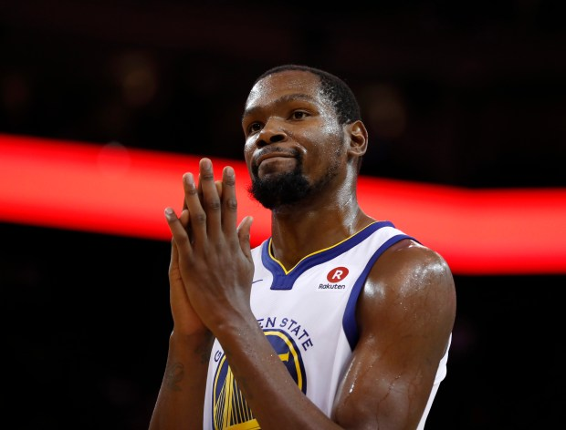Golden State Warriors' Kevin Durant (35) reacts to a play during their game against the Orlando Magic in the third quarter at Oracle Arena in Oakland, Calif. on Monday, Nov. 13, 2017. (Nhat V. Meyer/Bay Area News Group)