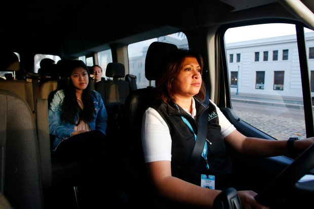 Mimi Nishiguchi rides aboard the Chariot bus driven by Yanira Linares, Tuesday, November 21, 2017, in San Francisco, California. (Karl Mondon/Bay Area News Group)