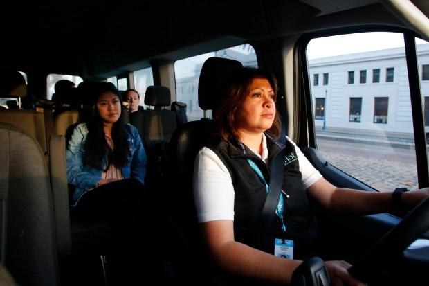 Mimi Nishiguchi rides aboard the Chariot bus driven by Yanira Linares, Tuesday, November 21, 2017, in San Francisco, California. (Karl Mondon/Bay Area News Group)