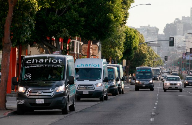 Chariot buses cue up for the morning commute, Tuesday, November 21, 2017, on Lombard Street in San Francisco, California. (Karl Mondon/Bay Area News Group)