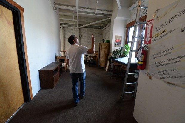 Property owner David Rose points out the sprinklers in the wide hallway of his live/work warehouse in Oakland, Calif., on Wednesday, Nov. 15, 2017. Since the deadly Ghost Ship fire, this is the first multi-unit warehouse property that has signed a compliance plan with the city. This particular warehouse was renovated after being purchased in the 1980s. It is built to the codes of that period. It does have some sprinklers, some earthquake retrofitting and other features some other warehouses where people are living lack. (Dan Honda/Bay Area News Group)