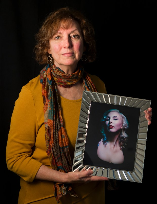 Colleen Dolan holds a photograph of her daughter Chelsea Faith Dolan, who died in the Oakland Ghost Ship warehouse fire, at her home in San Rafael, California on Wednesday, November 8, 2017. (LiPo Ching/Bay Area News Group)
