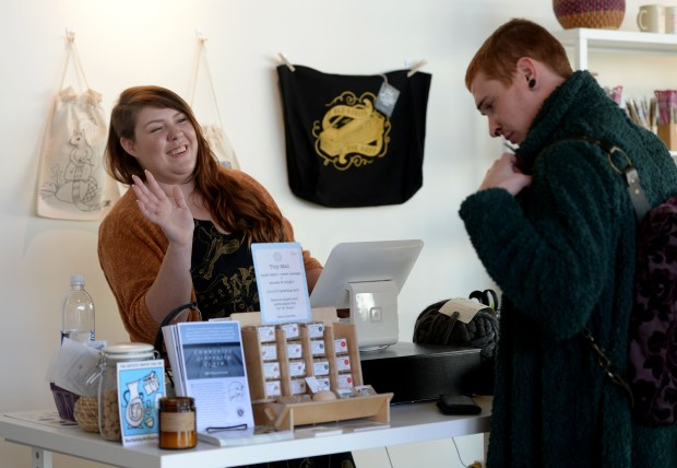 Owner Chase Clark waves to a customer at The Black Squirrel yarn and fabric store in Berkeley, Calif., on Thursday, Nov. 30, 2017. The store started out as a pop-up retail business to test out the concept and was so successful that Clark decided to sign a lease in the same space as the pop-up. (Dan Honda/Bay Area News Group)