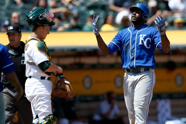 Kansas City Royals' Lorenzo Cain (6) celebrates after hitting a two-run home run scoring Drew Butera (9) in the fourth inning of their MLB game against the Oakland Athletics at the Coliseum in Oakland, Calif., on Wednesday, Aug. 16, 2017. (Jane Tyska/Bay Area News Group)