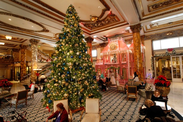 The lobby of the Fairmont Hotel sparkles with holiday decorations including a life size gingerbread house in San Francisco, Calif., on Monday, Dec. 7, 2015. (Laura A. Oda/Bay Area News Group)