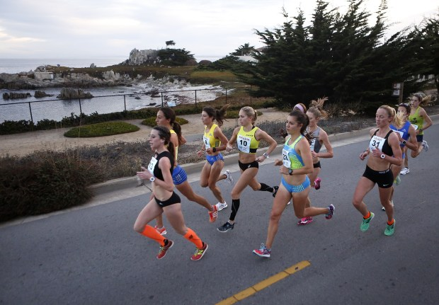 The pack of lead female runners pass by Hopkins Marine Station during the Monterey Bay Half Marathon in Pacific Grove, Calif. on Sunday November 12, 2017. (David Royal/Herald Correspondent)