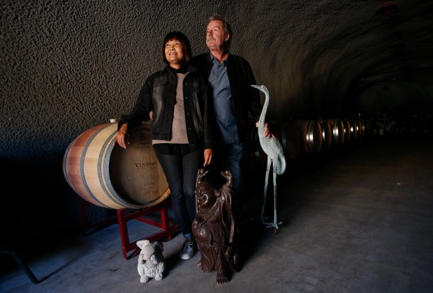Kiky Lee and Michael Parmenter lost their home in the Atlas Peak Fire last month but on Tuesday, November 14, 2017, they visited their wine cave that survived, along with a few salvaged yard ornaments. (Karl Mondon/Bay Area News Group)