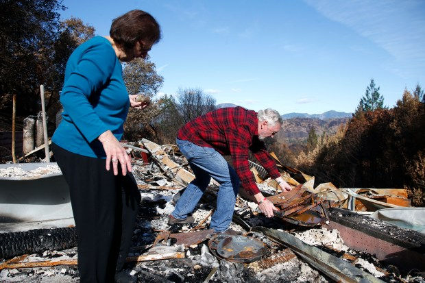 Will and Carol Ashford sift through the ruins of the home they lost in the Tubbs Fire east of Santa Rosa, California, Tuesday, November 14, 2017. (Karl Mondon/Bay Area News Group)