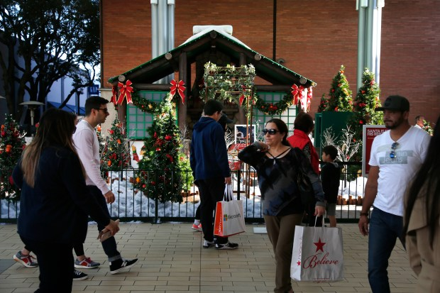 Shoppers pas by the Santa Village at the Stanford Shopping Mall on Sunday, November 12, 2017 in Palo Alto, California. The village was open for business on November 5. (Karl Mondon/Bay Area News Group)