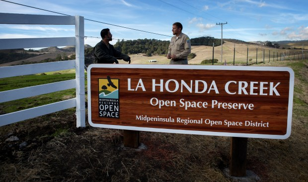 Steve Neighbors, left, and Don Mackessy, of the MidPeninsula Regional Open Space District, work to put the finishing touches on the entrance at the new La Honda Creek Open Space Preserve in La Honda, California, Tuesday, Nov. 28, 2017. On Friday, the MidPeninsula Regional Open Space District, which purchased the land in 2006, will open six miles of trails for hikers and horse riders through the former Driscoll Ranch, which it now calls the La Honda Creek Open Space Preserve. (Patrick Tehan/Bay Area News Group)
