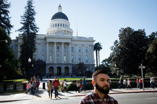 Pedestrians walk near the State Capitol in Sacramento on Nov. 7, 2017. The Sacramento area is seeing a wave of Bay Area transplants drawn to its relative affordability as prices soar in Oakland, San Jose and San Francisco. (Dai Sugano/Bay Area News Group)