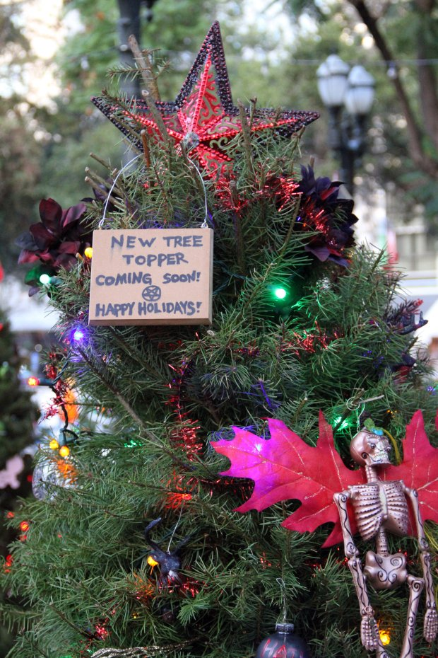 A new topper is coming to the Christmas in the Park tree decorated by the SanJose chapter of The Satanic Temple. A black goat head mask that was initially used as a topper was stolen late Saturday night or early Sunday morning. (Jason Green/Bay Area News Group)