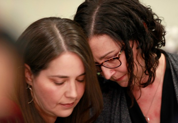 Former Presentation High School students Kathryn Leehane (right) and Cheryl Hodgkin Marshall hug during a press conference Wednesday, November 22, 2017, in San Jose, California, recalling allegations of pervasive sexual abuse of students at the prestigious all-girls Catholic high school. Leehane wrote an article in the Washington Post detailing her abuse at the school, and Marshall attended to offer her support. (Karl Mondon/Bay Area News Group)