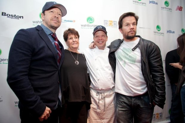 The Wahlbergs with mom Alma at the first Wahlburgers opening in 2011. (Photo courtesy of Wahlburgers)
