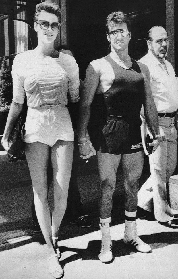Danish model and actress Brigitte Nielsen holds hands with actor Sylvester Stallone outside New York's Regency Hotel on Saturday, August 5, 1985. (AP Photo/Frankie Ziths)