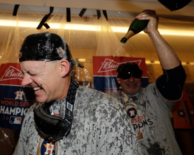 Houston Astros' A.J. Hinch celebrate after Game 7 of baseball's World Series against the Los Angeles Dodgers Wednesday, Nov. 1, 2017, in Los Angeles. The Astros won 5-1 to win the series 4-3. (AP Photo/David J. Phillip)
