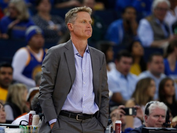 Golden State Warriors head coach Steve Kerr watches the game against the Orlando Magic in the first quarter at Oracle Arena in Oakland, Calif. on Monday, Nov. 13, 2017. (Nhat V. Meyer/Bay Area News Group)