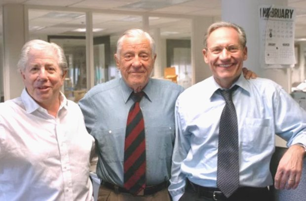 Former Washington Post executive editor Ben Bradlee, center, poses with Watergate reporters Carl Bernstein, left, and Bob Woodward at theWashington Post in May, 2005. (AP Photo/Katherine Frey/Washington Post)