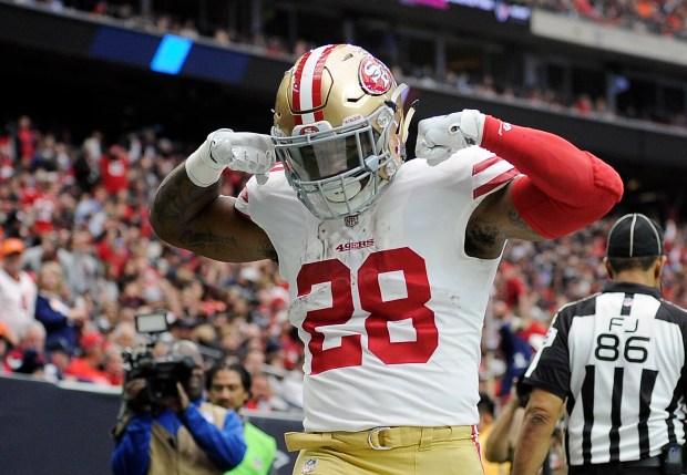 San Francisco 49ers running back Carlos Hyde celebrates after scoring a touchdown during the first half of an NFL football game against the Houston Texans, Sunday, Dec. 10, 2017, in Houston. (AP Photo/Eric Christian Smith)