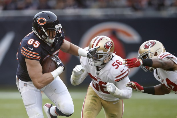 Daniel Brown #85 of the Chicago Bears carries the football against Reuben Foster #56 of the San Francisco 49ers in the fourth quarter at Soldier Field on December 3, 2017 in Chicago, Illinois. The San Francisco 49ers defeated the Chicago Bears 15-14. (Photo by Joe Robbins/Getty Images)