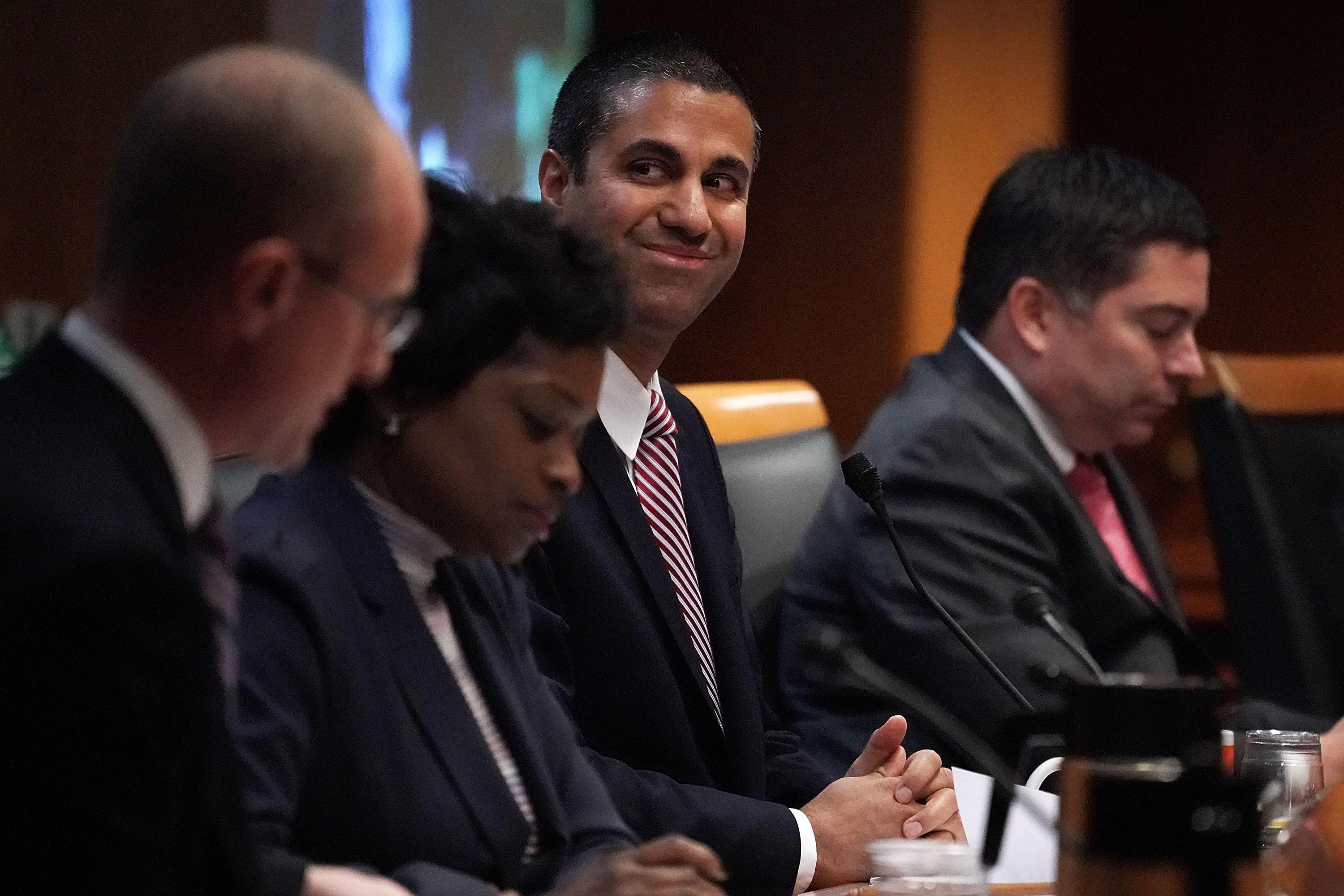 WASHINGTON DC- DECEMBER 14 Federal Communications Commission Chairman Ajit Pai smiles during a commission meeting