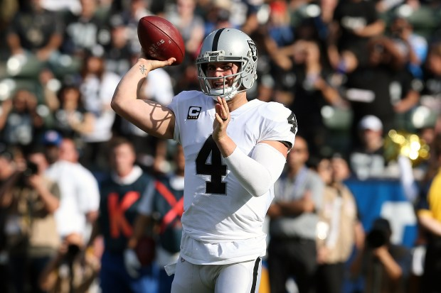 Derek Carr #4 of the Oakland Raiders throws a pass in the first quarter during the game against the Los Angeles Chargers at StubHub Center on December 31, 2017 in Carson, California. (Photo by Stephen Dunn/Getty Images)