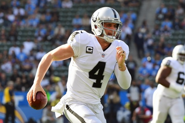 Derek Carr #4 of the Oakland Raiders scrambles out of the pocket during the first quarter of the game against the Los Angeles Chargers at StubHub Center on December 31, 2017 in Carson, California. (Photo by Harry How/Getty Images)